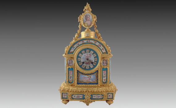 A Gilt Bronze and Blue Celeste Ground Sèvres Style Porcelain Clock by  Jean Baptiste Delettrez
