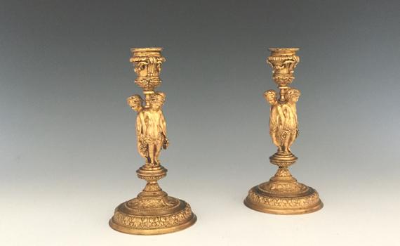 Antique Pair of Gilt Bronze Cherub Candlesticks