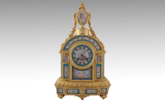 A Gilt Bronze and Blue Celeste Ground Sèvres Style Porcelain Clock by Jean Baptiste Delettrez