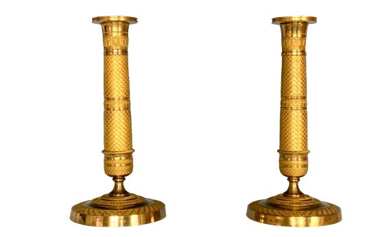 A Pair of Antique French Empire Gilt Bronze Candlesticks